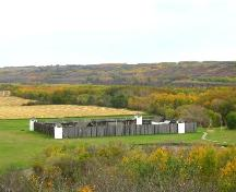 View northwest at the reconstructed fort in its valley setting, 2004.; Government of Saskatchewan, Marvin Thomas, 2004.