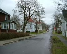 Looking east on north side of Alma Street, another entrance point to the District; Collins Heritage Conservation District, Yarmouth, 2005.; Heritage Division, NS Dept. of Tourism, Culture and Heritage, 2005.