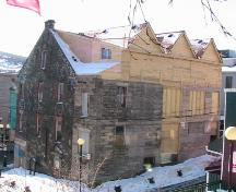Exterior photo of the rear facade of Yellow Belly Corner, shown during restoration work, photo circa 2005.; HFNL 2006