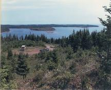 View towards Port Toulouse archaeology site, Nova Scotia, from Mount Granville, 1985.; Parks Canada 1985