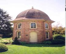 View of the peacock house from the north showing main entrance – June 2003; OHT, 2003