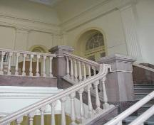 View of the main staircase in the Carnegie Library, Winnipeg, 2004; Historic Resources Branch, Manitoba Culture, Heritage and Tourism, 2004