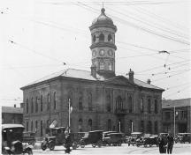 View of facade showing second clock tower added in 1865 and heightened in 1870 - c.1920; Archives of Ontario