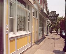 View of main (south) façade looking east on the north side of King Street West – July 2001; OHT, 2001