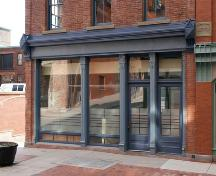 This image shows the restored street-level storefront.; Commercial Properties Limited