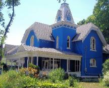 Bampfield Hall is easily recognizable by its Gothic features and bright blue exterior.; Photograph by Katie Hemsworth, 2007.