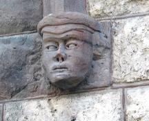 Detail of a sculpted head adjacent to one of the doors on the Peck Building, Winnipeg, 2005; Historic Resources Branch, Manitoba Culture, Heritage, Tourism and Sport, 2005