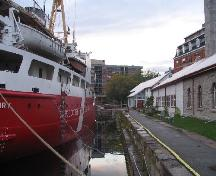 General view of the Kingston Dry Dock, showing the long, rectangular dock with 9.1 metres high stepped sides, 2008.; Agence Parcs Canada / Parks Canada Agency, David Henderson, 2008.