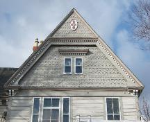 This photograph shows the ornate gable with fancy shingling and insignia near the peak, 2006; City of Saint John