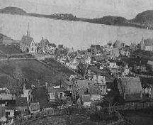 Historic photo of Trinity, Trinity Bay, NL, showing view from Gun Hill, including St. Paul's and Holy Trinity churches, looking towards Trinity Harbour, with Admiral's Point in the background, circa 1892-1935; Trinity Historical Society Archives, 2008