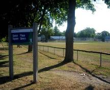 Image of Queen's Square showing signage and baseball field at the St. John Street side of the park; City of Fredericton