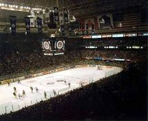 Interior view of a hockey game at Maple Leaf Gardens.; Parks Canada/Parcs Canada, 1980.
