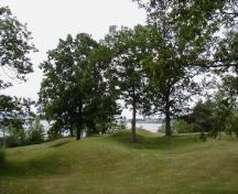 General view of Serpent Mounds, showing a grouping of burial mounds forming a serpentine shape, 2006.; Parks Canada Agency / Agence Parcs Canada, 2006.