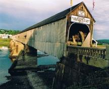 Image of the Hartland Covered Bridge taken during the summer of 2005. The bridge was opened in 1901 as a toll bridge until an election promise succeeded in getting rid of the tolls.; Doris E. Kennedy