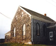 Side elevation, Old Guysborough Court House Museum showing porch and rear addition, Guysborough, 1989.; Heritage Division, NS Dept. Tourism, Culture and Heritage, 1989