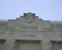 Detail view of crest and title of the Women's Tribute Memorial Lodge, Winnipeg, 2007; Historic Resources Branch, Manitoba Culture, Heritage and Tourism, 2007