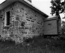 Corner view of the Jones Falls Defensible Lockmaster's House, showing the frame defensible porch, 1989.; Parks Canada Agency / Agence Parcs Canada, 1989.