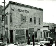 "Corner view of Mme. Tremblay's Store, showing the projecting lettering spelling out the name ""Mme Tremblay's Store"", 1948.; Library and Archives Canada / Bibliothèque et Archives Canada, 1948."