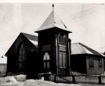 General view of St. Andrew's Presbyterian Church, showing the appearance of irregular massing due to the asymmetrical position of the tower, 1903.; National Archives of Canada / Archives nationales du Canada, 1903.