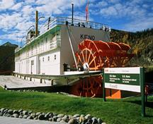 General view of the rear of the S.S. Keno showing the paddle wheels ensuring the completeness of its hull, superstructure, propulsion and auxiliary systems, 2002.; Parks Canada Agency / Agence Parcs Canada, J. Armitage, 2002.