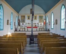 Interior view of Batoche showing its hall-plan design, with six Gothic-style windows along each side wall of the nave, 2007.; Parks Canada Agency / Agence Parcs Canada, David Venne, 2007.