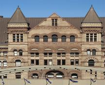 General view of Old Toronto City Hall and York County Court House, showing its elaborate stone detailing, including grotesques, voussoirs and carved window surrounds, mullions, colonettes, carved panels, 2007.; Old Toronto City Hall and York County Court House, deymosD, June 2007.